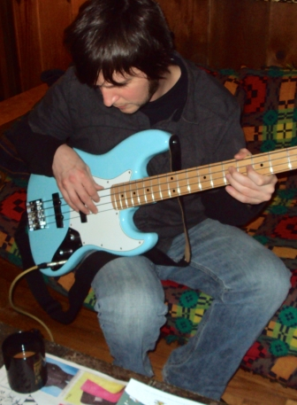 Adam playing powder blue Fender Jazz